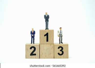 Business , Success concept. Businessmen miniature figures stand on number 1, 2 and 3 wooden block toys on white background
