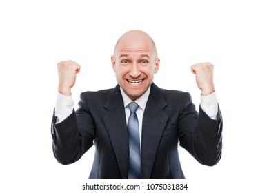 Business success concept - handsome happy smiling businessman winner gesturing hands fist raised up celebrating victory achievement white isolated