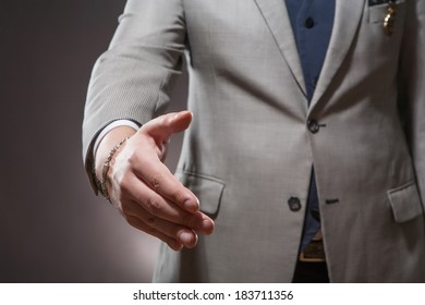 Business success and cooperation. Businessman takes his hand for a handshake.