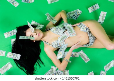 business success. investment in yourself. sexy woman in summer swimsuit in currency. body trade. money girl on green background. dollar bikini fashion. perfect body and hair. counterfeit money.
