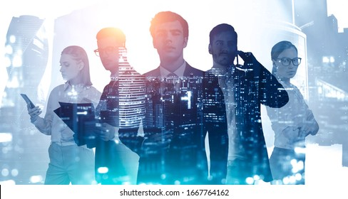 Business success and partnership concept. Silhouettes of young business people with double exposure of blurry abstract night city panorama. Toned image.