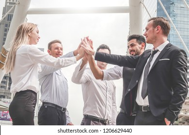 Business success Team which hand of the work force combine power tag team or Group of diversity people hand assemble high five for good teamwork, Successful project is done.