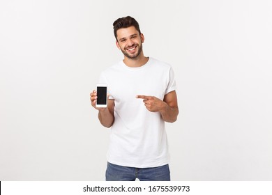 Business, success and technology concept with businessman showing smartphone with blank screen and copy space isolated on white.