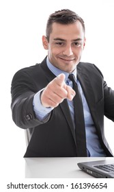 Business: successful man smiling and pointing at camera isolated on white background - it's your turn