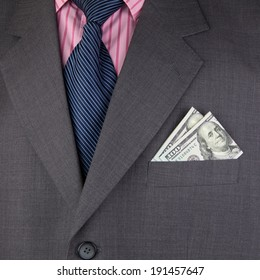 Business suit and dollar in a pocket