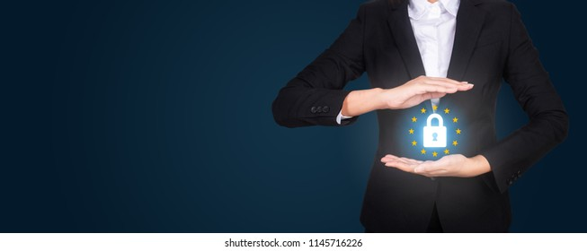 business in suit protecting word GDPR with hands, General Data Protection Regulation (GDPR)