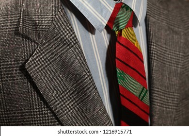 A business suit and shirt with an Igorot tie, woven in Sagada. The Igorot are natives in the highlands of Luzon, Philippines, who used to be head hunters.