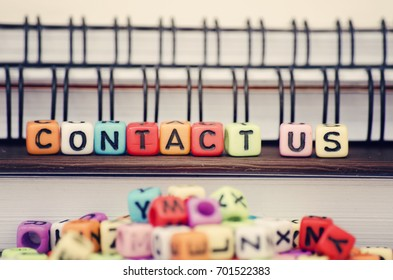 Business and support concept, cube dices with word CONTACT US. Selective focus and shallow depth of field