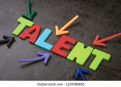 Business talents finding, recruitment for HR, Human Resource concept, colorful arrows pointing to alphabet TALENT at the center of chalkboard, searching for the right ability or skill people.