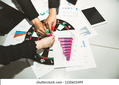 Business target goal teamwork concept, Circular target marked with numbers and red dart against businessman and woman background