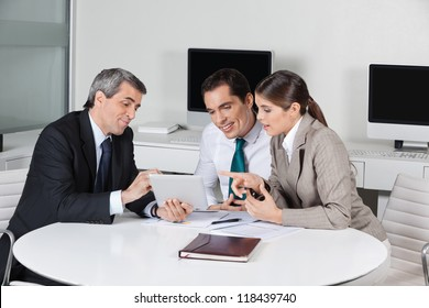 Business tax consultant with tablet computer in a meeting in the office