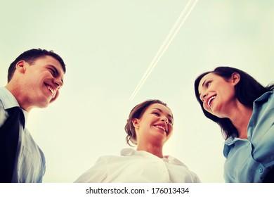 Business team, against blue sky