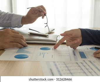 Business team analyze financial numbers to view the performance of the company. Concept of accounts, meeting.
