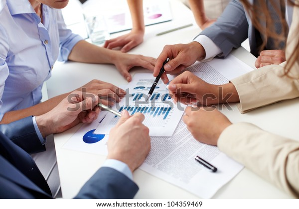 Business team analyzing current situation in the company to gain better future results