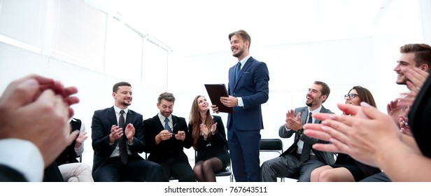 business team applauding the coach