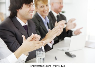 business team applauding at a conference or board meeting