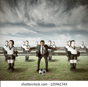 Business team attack in a green field