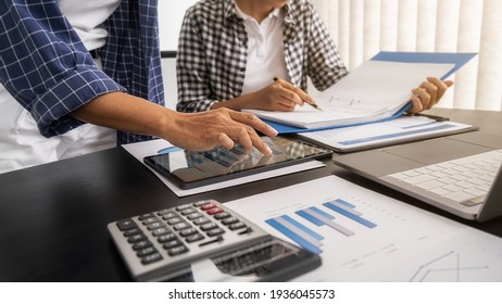 Business team brainstorming and discussing with financial data and report graph. Teamwork meeting working concept.