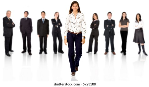 business team with a businesswoman walking forward leading it - be different concept - isolated over a white background