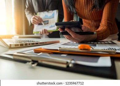 Business team to calculate financial information to invest in new projects. financial manager meeting.euing Smart phones and laptops and digital tablet PCs in modern office.
