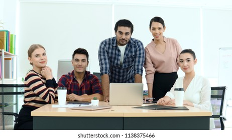 Business team in casual dresses in the workplace.
