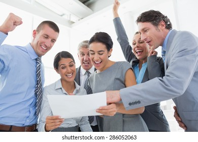 Business team celebrating a new contract in the office