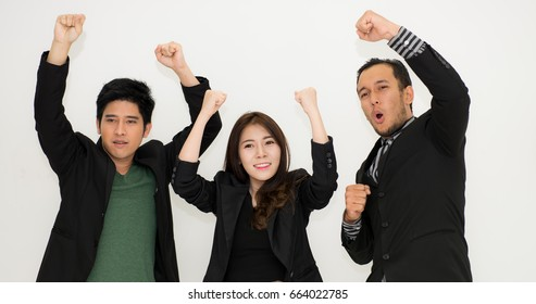 Business team celebrating a triumph with arms up,Victorious corporate man celebrating with his arms lifted in the air,Happy business people with arms up celebrating - isolated over white,