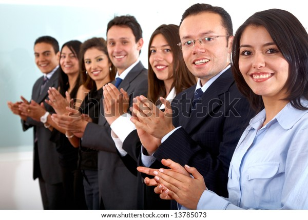 business team clapping a good presentation in an office