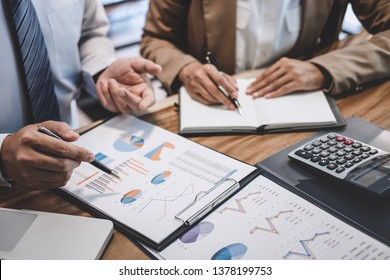 Business team colleague working with new startup project plan and discussion information for financial strategy with laptop, results of their successful teamwork.