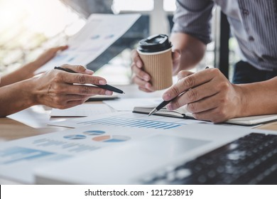 Business team colleagues discussing working analysis with financial data and marketing growth report graph in team, Meeting Talking Brainstorming Communication Concept.