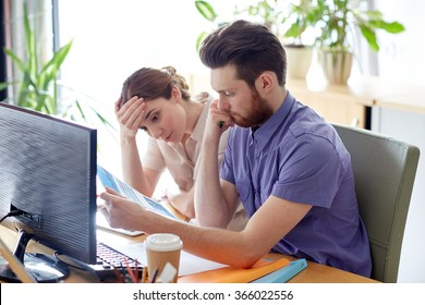 business team with computer and files in office