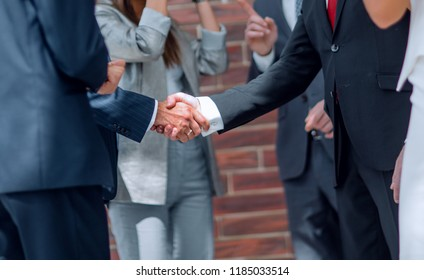 business team congratulates partners with the conclusion of the transaction
