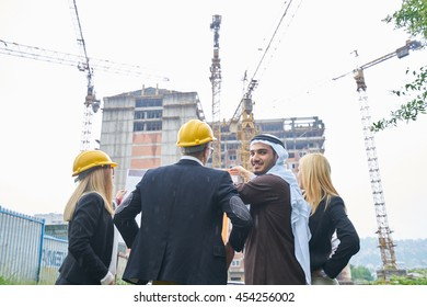 Business team construction engineer architect and worker looking building model and blueprint planbleprint plans