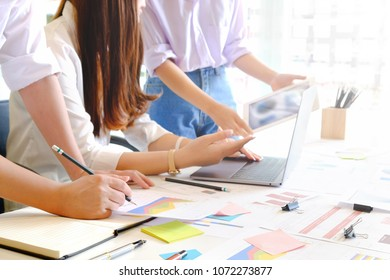 Business team consult with tablet and computer in office.