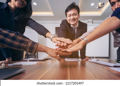 Business team to cooperate in the work in the enterprise. Merger and acquisition. Team join forces for project.Copy space.