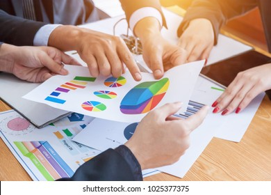 Business Team Corporate Organization Meeting Concept,Business people showing team work while working in board room in office interior. People helping one of their colleague to finish new business plan