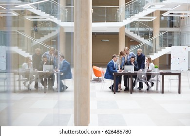 Business team and coworkers are discussing about global economy with laptop and graph screen. Startup business teamwork brainstorming meeting concept. People working planning start up.