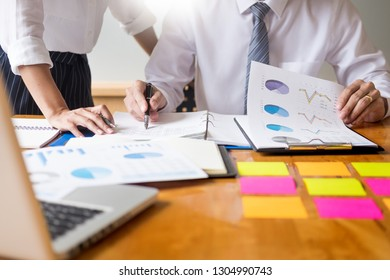 Business team data analyzing income charts document during discussion explain strategy meeting. on start-up project teamwork together