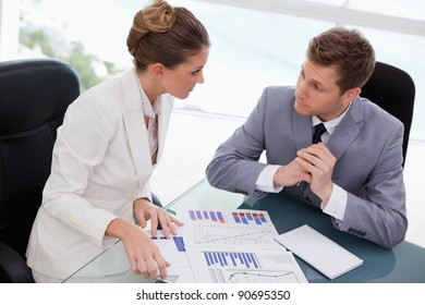 Business team deliberating on market research results