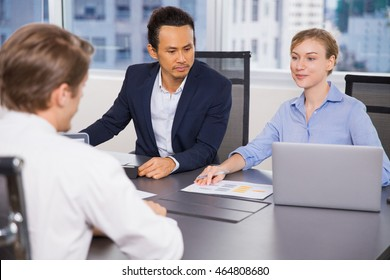 Business Team Discussing Documents