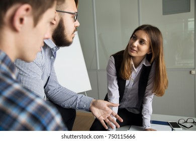 Business team discussing a strategy to promote a new project