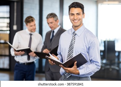 Business team with document and organizer in office