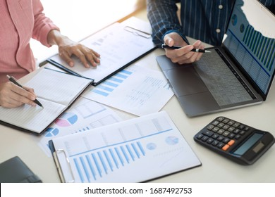 Business Team Entrepreneur discussing and analysis report chart data in office, brainstorming in Meeting and successful teamwork Concept
