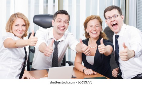 Business team express positivity on meeting in board room