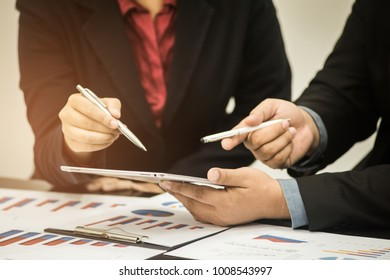 Business team financial inspector and secretary making report,tax,calculating or checking balance, Audit concept at working with plan and analyzing investment charts at workplace.