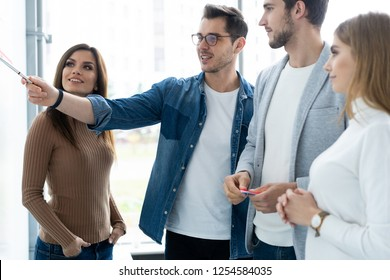 business team with flip board in office discussing something