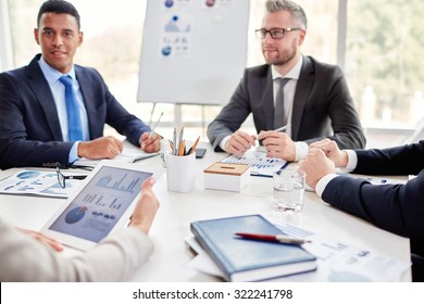 Business team gathered by workplace for consultation