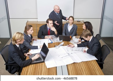 A business team going over the design changes at a corporate architectural firm