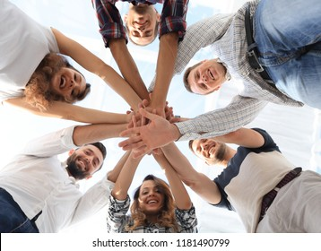 business team with hands clasped together