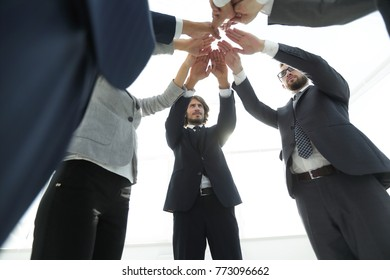 business team with hands clasped together.t